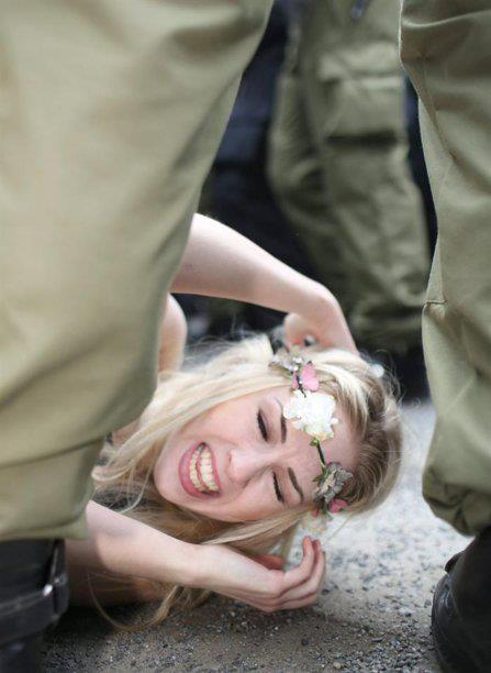 Juxtaposition of jackboots and flowers. (from a FEMEN protest)