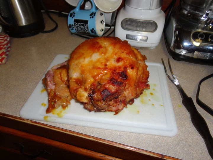 Cooked glazed ham ready for carving and eating!